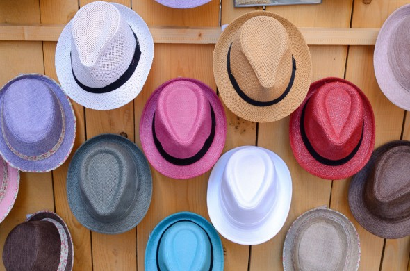 Castellane, France, France --- Display of Straw Hats for Sale in Milliners Hat Shop Castellane France --- Image by © Chris Hellier/Corbis